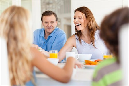 family table eating together - Family eating together at table Stock Photo - Premium Royalty-Free, Code: 649-05949941