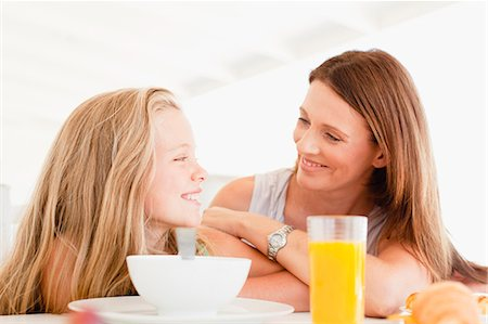 family table eating together - Mother talking to daughter at breakfast Stock Photo - Premium Royalty-Free, Code: 649-05949955
