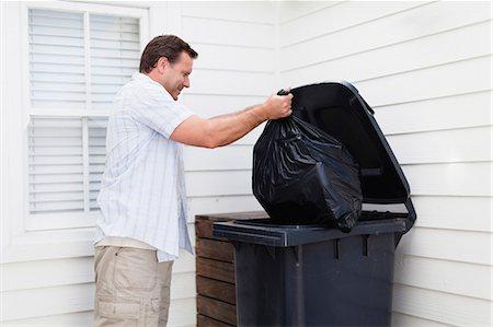 Man taking out garbage Stock Photo - Premium Royalty-Free, Code: 649-05950009