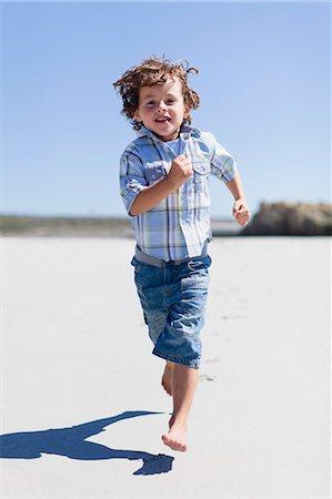 Boy running on sandy beach Stock Photo - Premium Royalty-Free, Code: 649-05950011