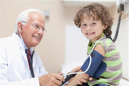 Doctor examining boy in office Stock Photo - Premium Royalty-Free, Code: 649-05950083