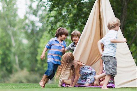 Children playing in tent outdoors Stock Photo - Premium Royalty-Free, Code: 649-05950115