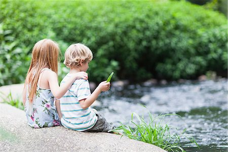Children sitting on rock together Stock Photo - Premium Royalty-Free, Code: 649-05950123
