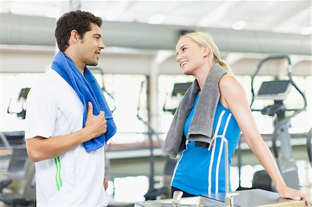 flirting - Couple talking in gym Stock Photo - Premium Royalty-Free, Code: 649-05950147