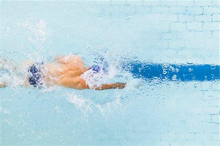 swimming - Swimmer following pool lane Stock Photo - Premium Royalty-Free, Code: 649-05950226