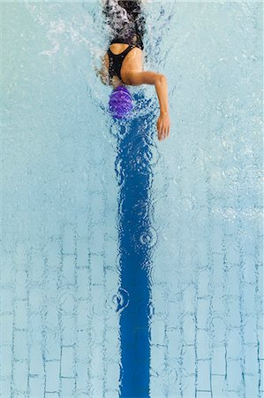 property release - Swimmer following pool lane Stock Photo - Premium Royalty-Free, Code: 649-05950227