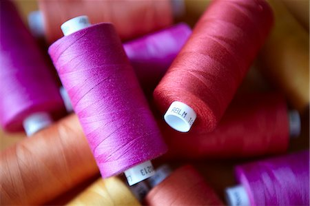 pink - Close up of colorful spools of thread Stock Photo - Premium Royalty-Free, Code: 649-05950259