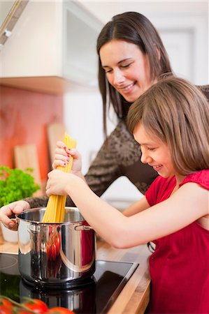 stove - Mother and daughter cooking together Stock Photo - Premium Royalty-Free, Code: 649-05950586