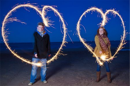 Couple playing with sparklers on beach Stock Photo - Premium Royalty-Free, Code: 649-05950697