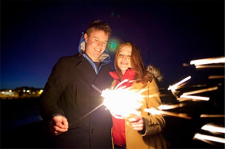 Couple playing with sparklers on beach Stock Photo - Premium Royalty-Free, Code: 649-05950699