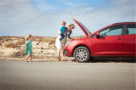 Mother examining broken down car Stock Photo - Premium Royalty-Free, Code: 649-05950800