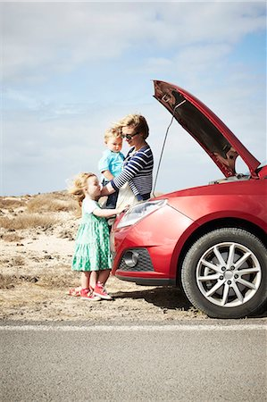 Family sitting by broken down car Stock Photo - Premium Royalty-Free, Code: 649-05950801