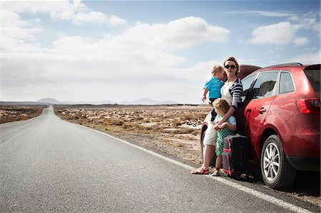 Family standing by broken down car Stock Photo - Premium Royalty-Free, Code: 649-05950802