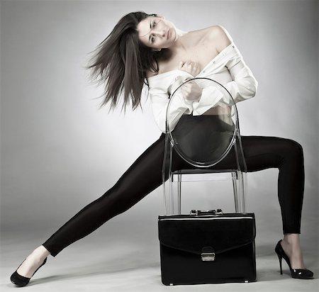 sexi women full body - Businesswoman sitting in plastic chair Stock Photo - Premium Royalty-Free, Code: 649-05951199