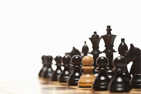 strategy - White pawn in black chess set Stock Photo - Premium Royalty-Free, Code: 649-05951268