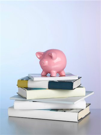 Piggy bank on stack of books Stock Photo - Premium Royalty-Free, Code: 649-06000338