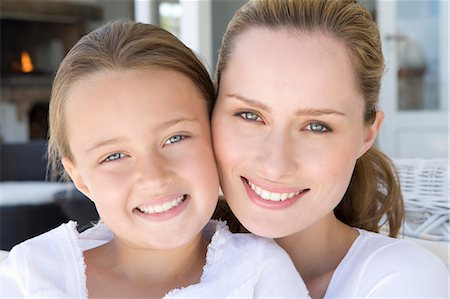 Close up of mother and daughters faces Stock Photo - Premium Royalty-Free, Code: 649-06000364