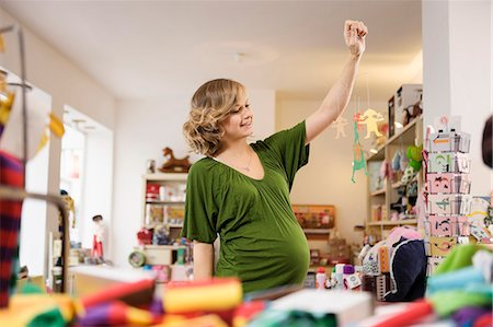 pregnant low angle - Pregnant woman playing with toys Stock Photo - Premium Royalty-Free, Code: 649-06000407