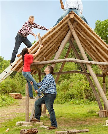 People building log hut together Stock Photo - Premium Royalty-Free, Code: 649-06000601