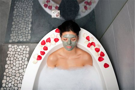 Woman with face mask in bubble bath Stock Photo - Premium Royalty-Free, Code: 649-06000627