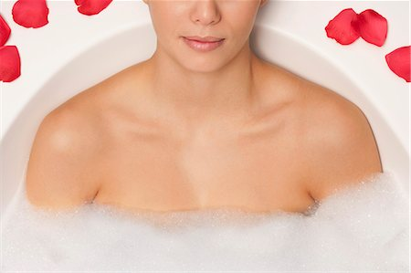 Woman relaxing in bubble bath Stock Photo - Premium Royalty-Free, Code: 649-06000622