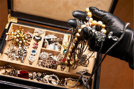 expensive jewelry - Gloved hand stealing jewelry Stock Photo - Premium Royalty-Free, Code: 649-06000729