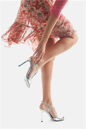 Woman adjusting sandals Stock Photo - Premium Royalty-Free, Code: 649-06000744