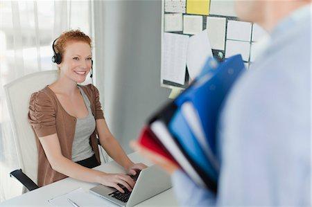 Businesswoman wearing headset at desk Stock Photo - Premium Royalty-Free, Code: 649-06000905