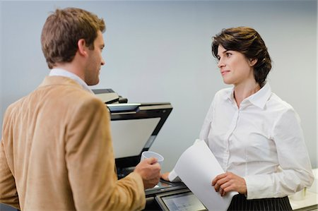 Business people talking at copier Stock Photo - Premium Royalty-Free, Code: 649-06000952