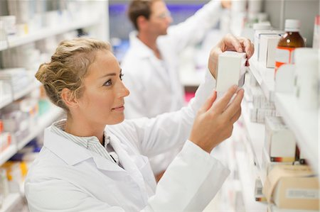 supply - Pharmacists browsing medicines on shelf Stock Photo - Premium Royalty-Free, Code: 649-06001025