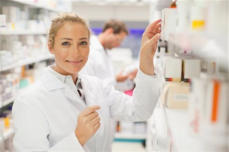 supply - Pharmacists browsing medicines on shelf Stock Photo - Premium Royalty-Free, Code: 649-06001026