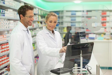 Pharmacists using computer at counter Stock Photo - Premium Royalty-Free, Code: 649-06001044