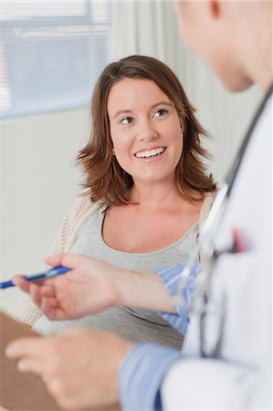 pregnant woman with doctor - Doctor and patient talking in office Stock Photo - Premium Royalty-Free, Code: 649-06001097