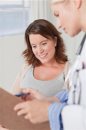 Doctor and patient talking in office Stock Photo - Premium Royalty-Free, Code: 649-06001098