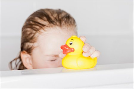 Girl playing with rubber duck in bath Stock Photo - Premium Royalty-Free, Code: 649-06001161