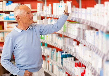 Customer browsing on drugstore shelves Stock Photo - Premium Royalty-Free, Code: 649-06001328
