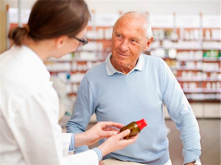 Pharmacist talking to patient in store Stock Photo - Premium Royalty-Free, Code: 649-06001320