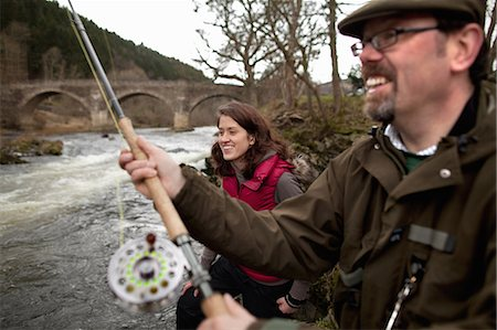 Couple fishing for salmon in river Stock Photo - Premium Royalty-Free, Code: 649-06001368