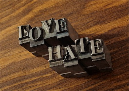 """stamped - Lead type spelling """"love"""" and """"hate"""" Stock Photo - Premium Royalty-Free, Code: 649-06001434"""