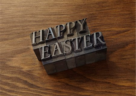 "stamped - Lead type spelling ""Happy Easter"" Stock Photo - Premium Royalty-Free, Code: 649-06001435"