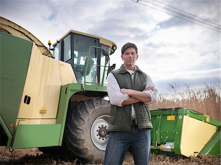Farmer with tractor in elephant grass Stock Photo - Premium Royalty-Free, Code: 649-06001456