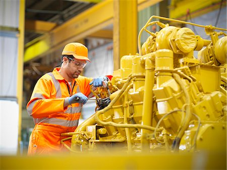 east indian (male) - Apprentice engineer at work in factory Stock Photo - Premium Royalty-Free, Code: 649-06001474