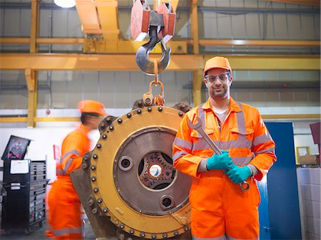 east indian (male) - Apprentice engineer holding wrench Stock Photo - Premium Royalty-Free, Code: 649-06001483