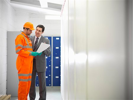 east indian (male) - Apprentice engineer with businessman Stock Photo - Premium Royalty-Free, Code: 649-06001492