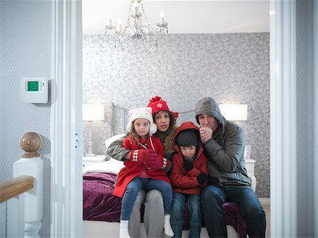 Family wearing snow gear in bedroom Stock Photo - Premium Royalty-Free, Code: 649-06001536