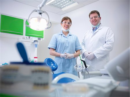 Dental student and dentist in surgery Stock Photo - Premium Royalty-Free, Code: 649-06001579