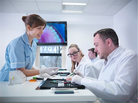 dentistry - Dentist teaching students in class Stock Photo - Premium Royalty-Free, Code: 649-06001573