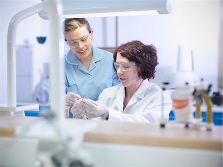 Dentist teaching student in lab Stock Photo - Premium Royalty-Free, Code: 649-06001584