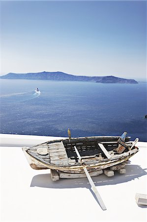 santorini island - Weathered wooden boat on balcony Stock Photo - Premium Royalty-Free, Code: 649-06001725