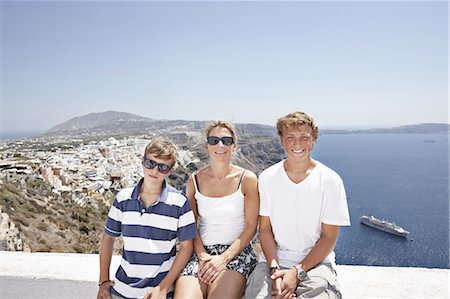 Family smiling on balcony together Stock Photo - Premium Royalty-Free, Code: 649-06001721